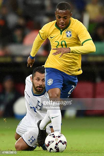 Robinho of Brazil and Alfredo Mejía of Honduras compete for the ball during the International Friendly Match between Brazil and Honduras at Beira Rio...