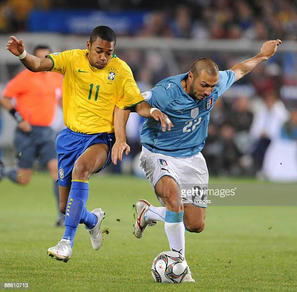 Robinho of Brazil and Andrea Dossena of Italy vie for the ball during the FIFA Confederations Cup match between Italy and Brazil at the Loftus...