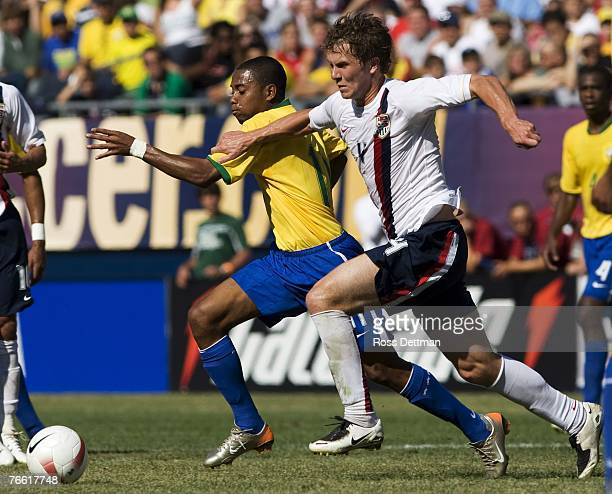 Robinho of Brazil battles for the ball with USA's Michael Bradley during the international friendly match between Brazil and the US Men's National...