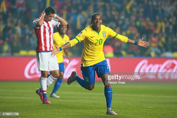 Robinho of Brazil celebrates after scoring the opening goal during the 2015 Copa America Chile quarter final match between Brazil and Paraguay at...