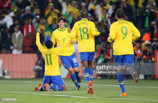 Robinho of Brazil celebrates with his team mates after scoring to make it 30