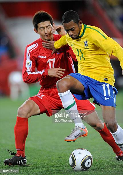 Robinho of Brazil controls the ball against An Yong Hak of North Korea during the 2010 FIFA World Cup South Africa Group G match between Brazil and...