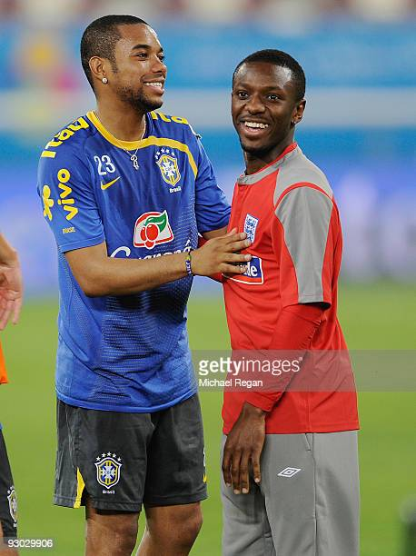 Robinho of Brazil greets Manchester City team mate Shaun WrightPhillips during the England training session at the Khalifa Stadium on November 13...