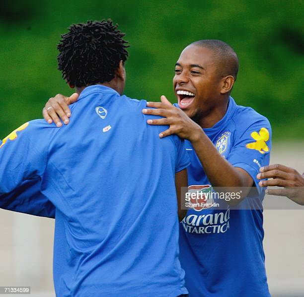 Robinho of Brazil has a laugh with Ze Roberto during the Brazil National Football Team training session for the FIFA World Cup Germany 2006 at the...