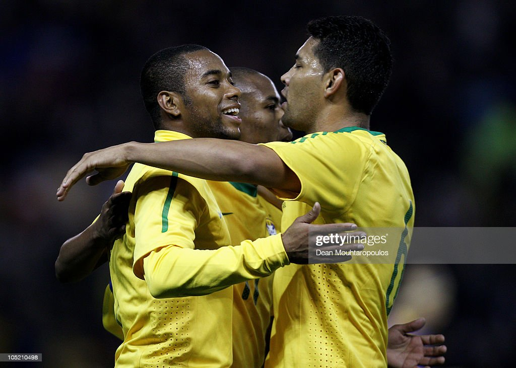 Robinho of Brazil is congratulated by team mates after he set up the first goal of the game for Daniel Alves during the International Friendly match between Brazil and Ukraine at Pride Park Stadium on October 11, 2010 in Derby, England.