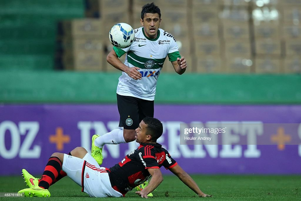 Robinho of Coritiba competes for the ball with Recife of Flamengo during the match between Coritiba and Flamengo for the Brazilian Series A 2014 at Couto Pereira stadium on August 17, 2014 in Curitiba, Brazil.