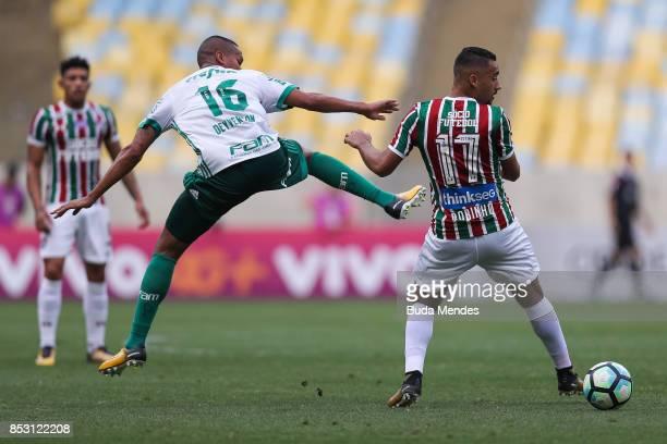 Robinho of Fluminense struggles for the ball with Deyverson of Palmeiras during a match between Fluminense and Palmeiras as part of Brasileirao...
