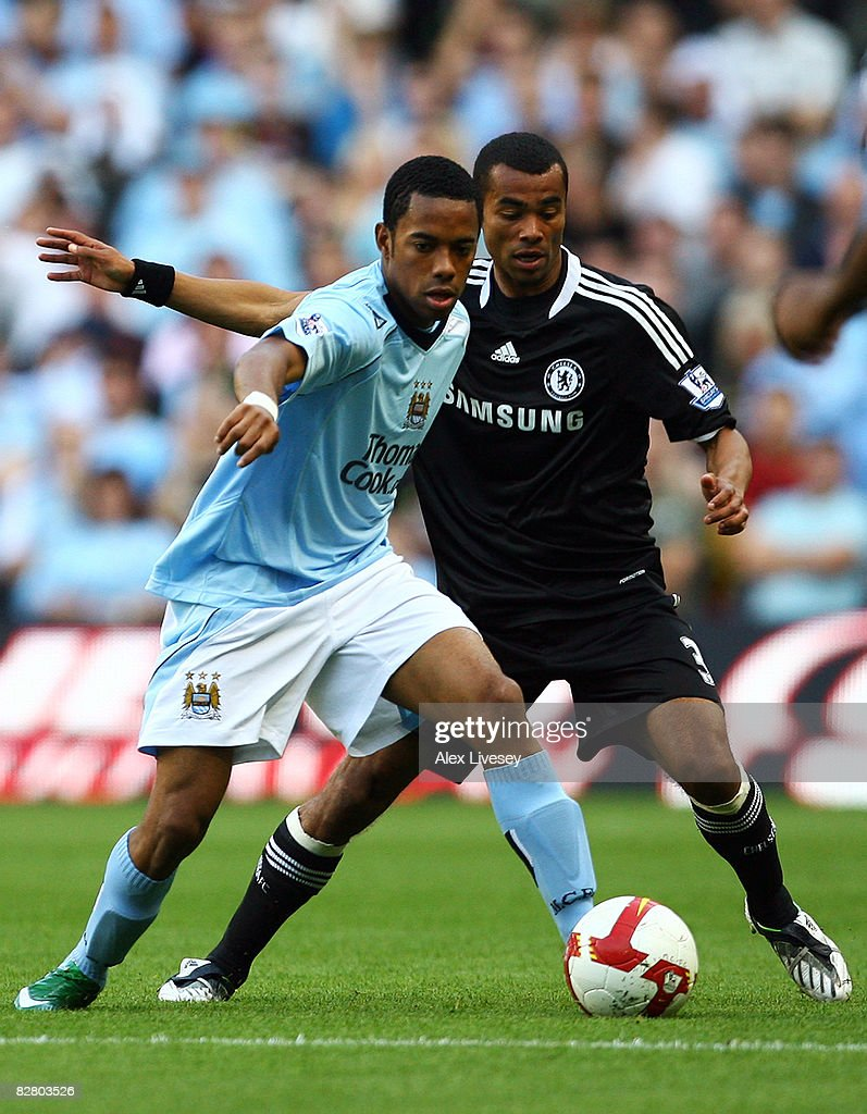 Robinho of Manchester battles with Ashley Cole of Chelsea during the Barclays Premier League match between Manchester City and Chelsea at The City of Manchester Stadium on September 13, 2008 in Manchester, England.