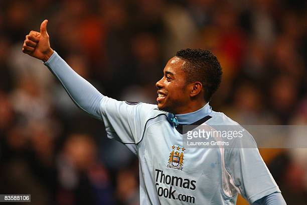 Robinho of Manchester City celebrates scoring his team's second goal during the UEFA Cup Group A match between Manchester City and FC Twente at The...