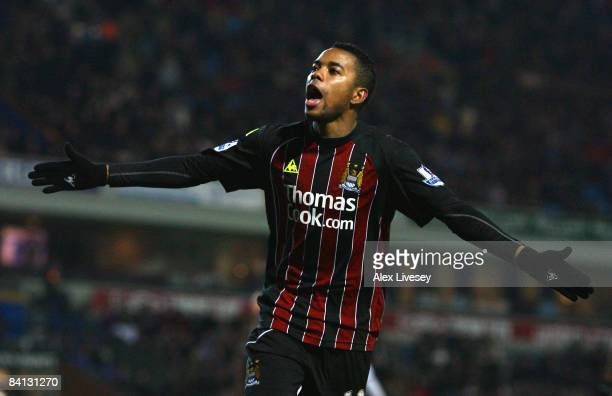 Robinho of Manchester City celebrates scoring his team's second goal during the Barclays Premier League match between Blackburn Rovers and Manchester...