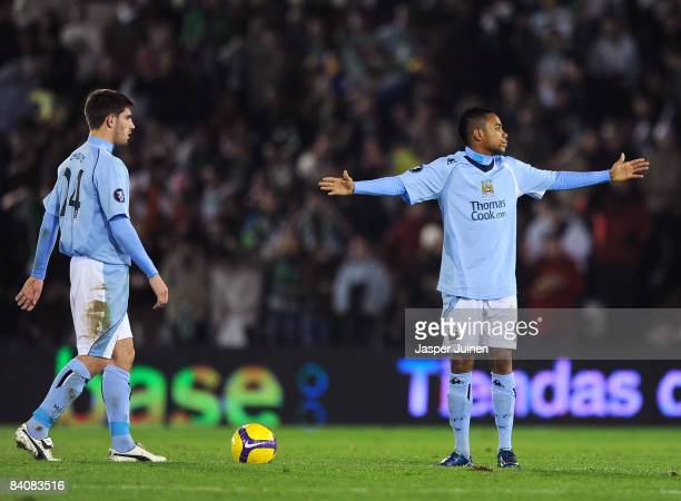 Robinho of Manchester City reacts flanked by his teammate Ched Evans after conceding a goal during the UEFA Cup group A match between Racing...
