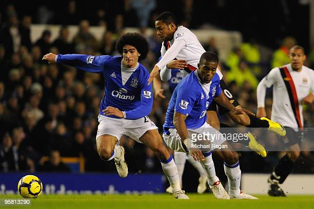 Robinho of Manchester City tangles with Marouane Fellaini and Sylvain Distin of Everton during the Barclays Premier League match between Everton and...