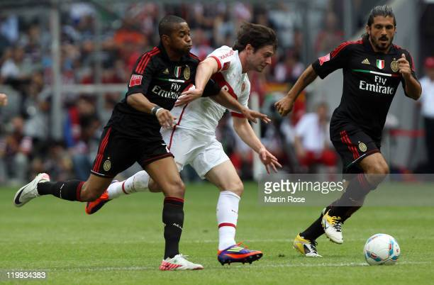 Robinho of Milan and Joao Paulo of Alegre battle for the ball during the Audi Cup third place match between AC Milan and International De Porto...