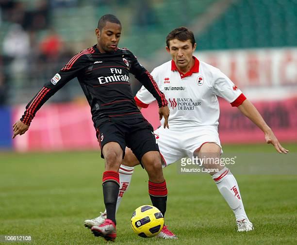 Robinho of Milan is challenged by Vitali Kutuzov during the Serie A match between Bari and Milan at Stadio San Nicola on November 7, 2010 in Bari,...