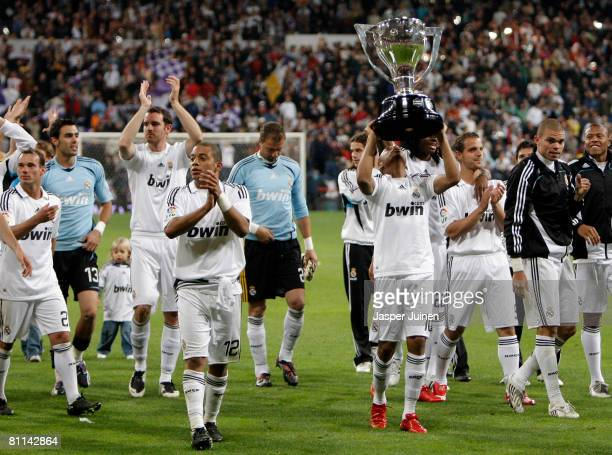 Robinho of Real Madrid holds the La Liga trophy alloft at the end of the La Liga match between Real Madrid and Levante at the Santiago Bernabeu...