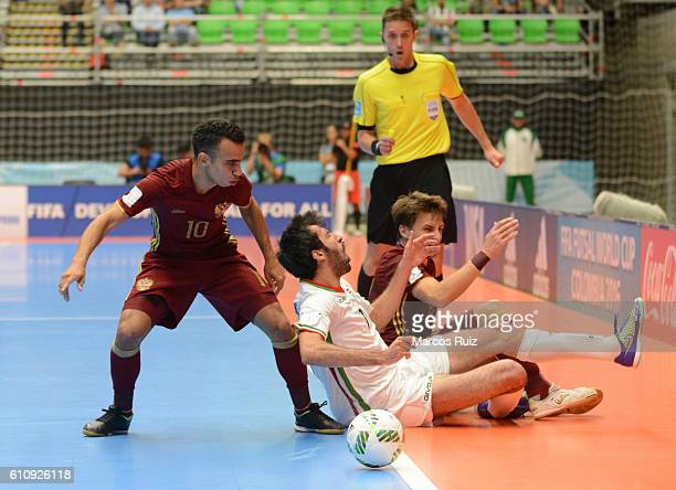 Robinho of Russia fights for the ball with Ahmad Esmaeilpour of Iran during a semi final match between Iran and Russia as part of 2016 FIFA Futsal...
