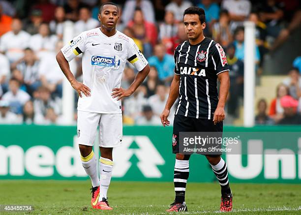 Robinho of Santos and Jadson of Corinthians in action during the match between Santos and Corinthians for the Brazilian Series A 2014 at Vila Belmiro...