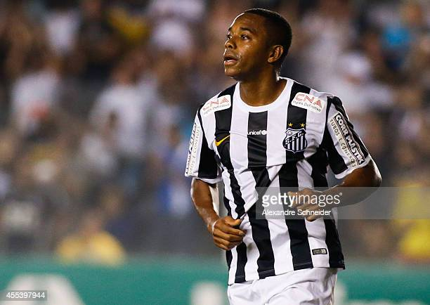 Robinho of Santos celebrates their second goal during the match between Santos and Coritiba for the Brazilian Series A 2014 at Vila Belmiro stadium...
