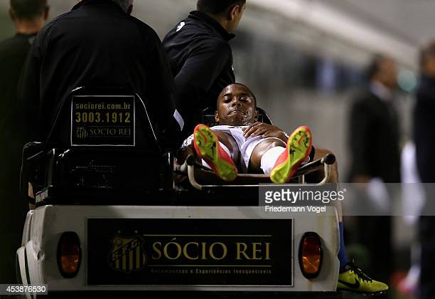 Robinho of Santos is injured during the match between Santos and Atletico PR for the Brazilian Series A 2014 at Vila Belmiro stadium on August 20,...