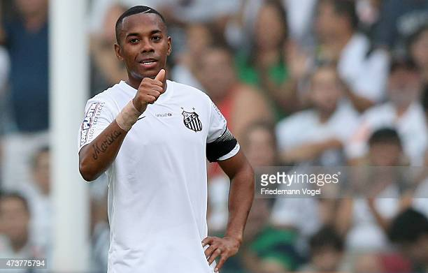 Robinho of Santos reacts during the match between Santos and Cruzeiro for the Brazilian Series A 2015 at Vila Belmiro Stadium on May 17, 2015 in...