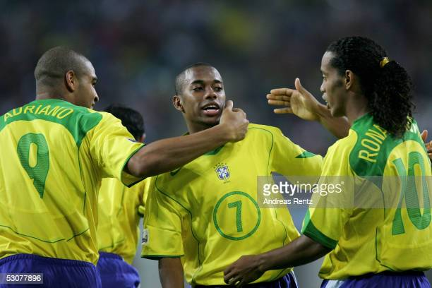 Robinho scorer of the second goal celebrates with Adriano and Ronaldinho of Brazil during the FIFA Confederations Cup 2005 match between Brazil and...