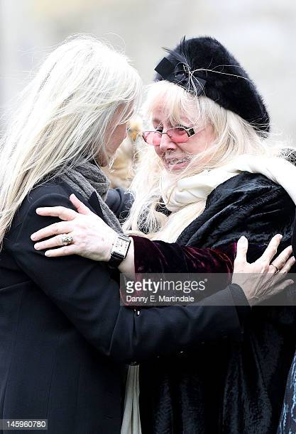 Robin's widow Dwina Murphy Gibb is comforted by a friend at the funeral of Robin Gibb held at St. Mary's Church, Thame on June 8, 2012 in Oxford,...