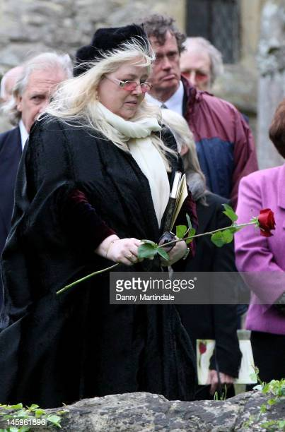 Robin's widow Dwina Murphy Gibb places a rose on the coffin at the funeral of Robin Gibb held at St. Mary's Church, Thame on June 8, 2012 in Oxford,...