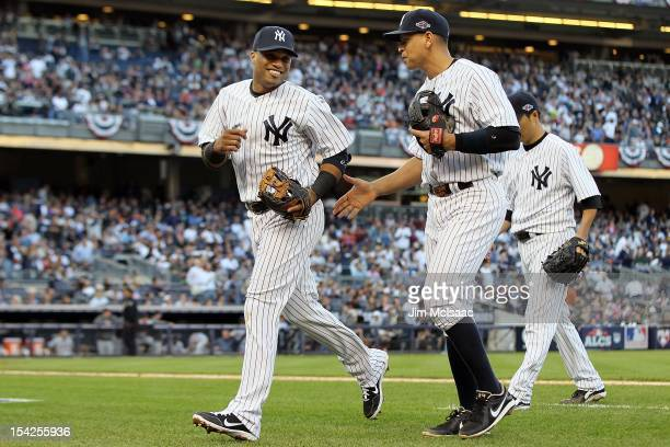 Robinson Cano and Alex Rodriguez of the New York Yankees in action against the Detroit Tigers during Game Two of the American League Championship...