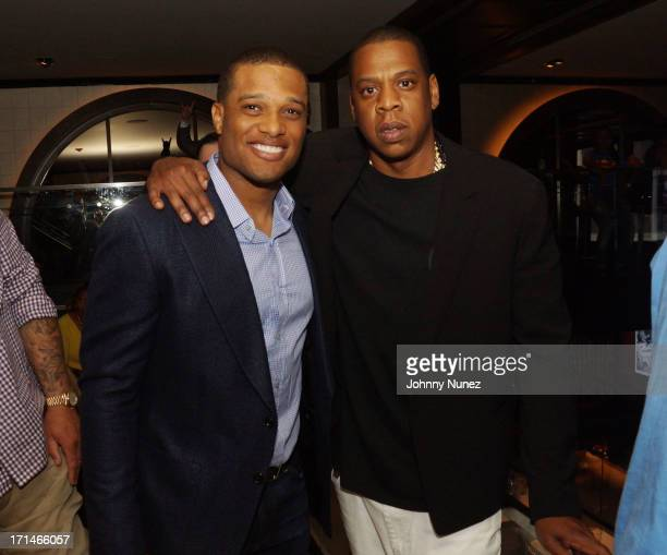 Robinson Cano and JayZ attend The 'Super Heroes' Fundraiser And Domino Tournament at The 40/40 Club on June 24 2013 in New York City