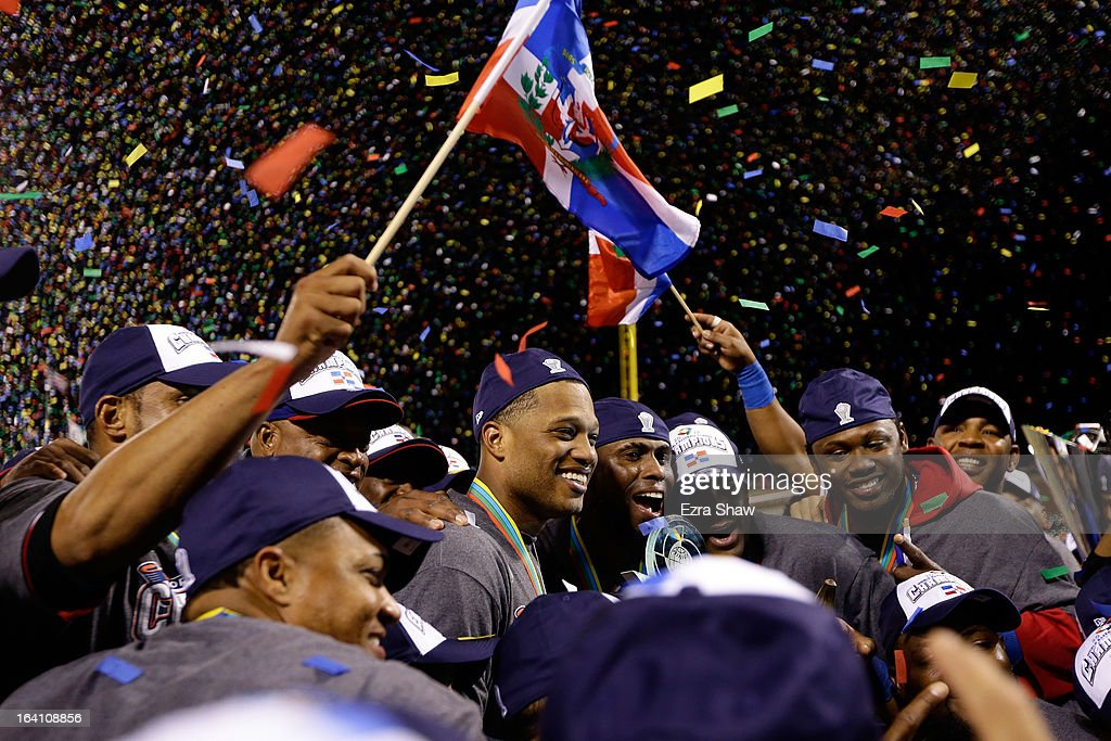 Robinson Cano #24 and Jose Reyes #7 of the Dominican Republic celebrate after defeating Puerto Rico to win the Championship Round of the 2013 World Baseball Classic by a score of 3-0 at AT&T Park on March 19, 2013 in San Francisco, California.