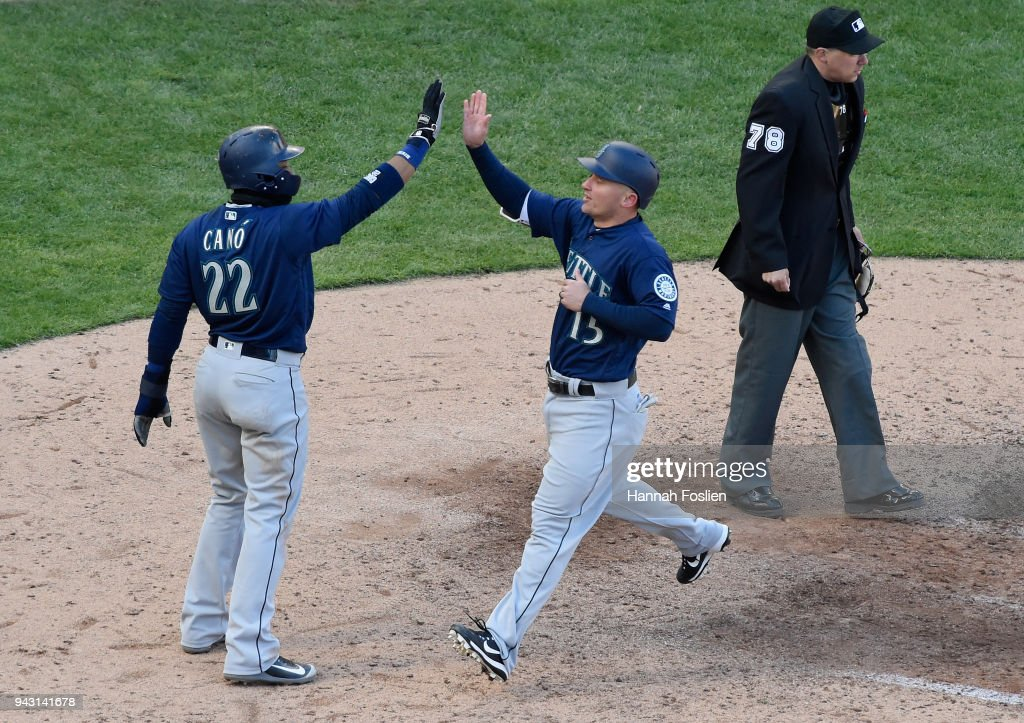 Robinson Cano #22 and Kyle Seager #15 of the Seattle Mariners celebrate scoring against the Minnesota Twins during the eighth inning of the game on April 7, 2018 at Target Field in Minneapolis, Minnesota. The Mariners defeated the Twins 11-4.