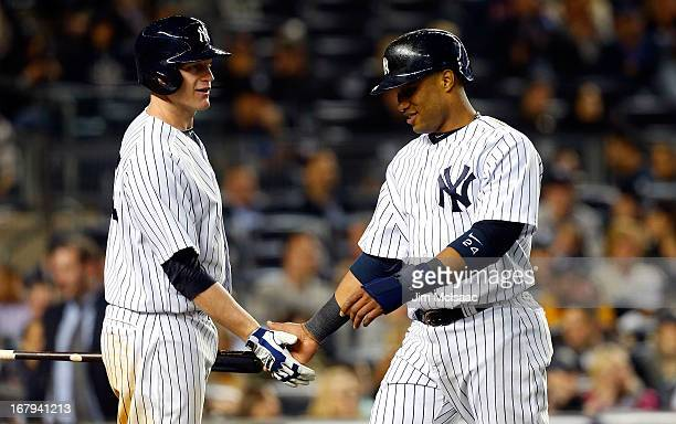 Robinson Cano and Lyle Overbay of the New York Yankees in action against the Toronto Blue Jays at Yankee Stadium on April 26 2013 in the Bronx...