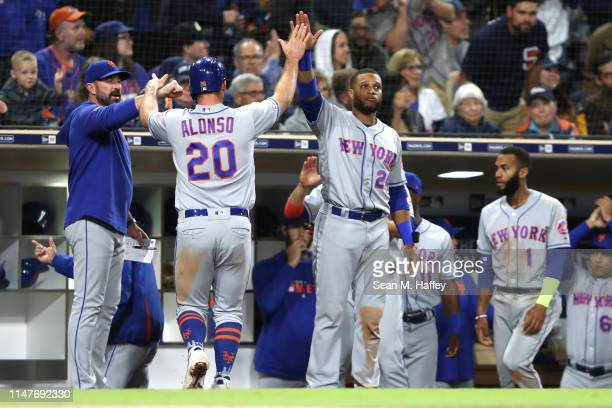 Robinson Cano congratulates Pete Alonso after he scored on a sacrifice fly by Michael Conforto of the New York Mets during the seventh inning of a...