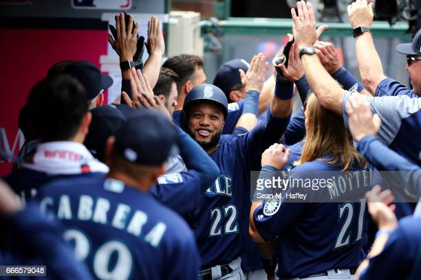Robinson Cano is congratulated in the dugout after hitting a threerun home run during the third inning of a game against the Los Angeles Angels of...