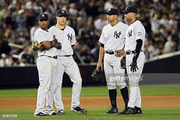 Robinson Cano Mark Teixeira Alex Rodriguez and Derek Jeter of the New York Yankees look on during a pitching change while playing against the...