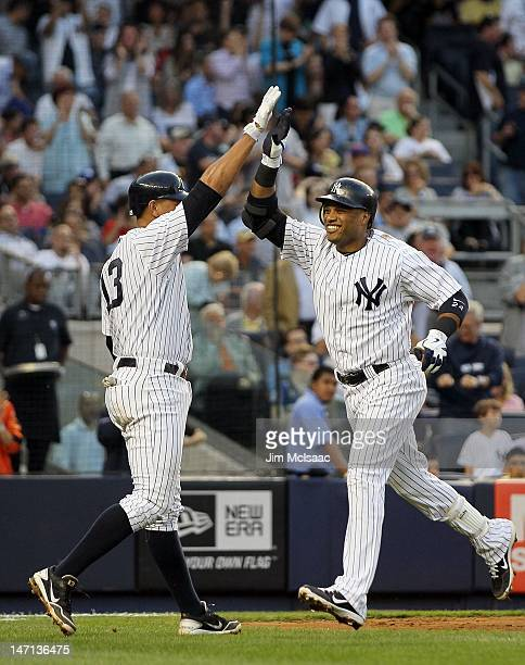 Robinson Cano of the New York Yankees celebrates his home run against the New York Mets with teammate Alex Rodriguez at Yankee Stadium on June 8 2012...