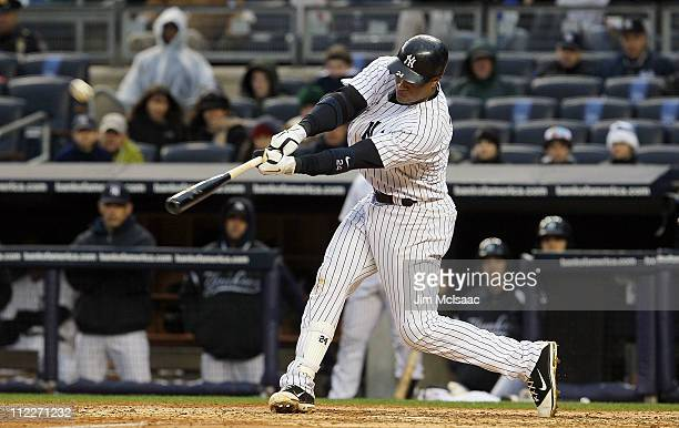 Robinson Cano of the New York Yankees connects on a eighthinning tworun home run against the Texas Rangers on April 16 2011 at Yankee Stadium in the...