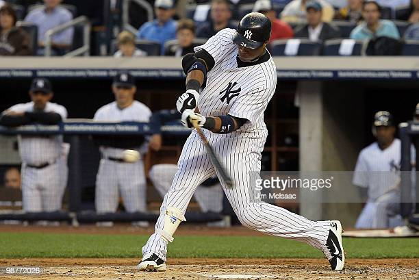 Robinson Cano of the New York Yankees connects on a first inning RBI single against the Chicago White Sox on April 30 2010 at Yankee Stadium in the...