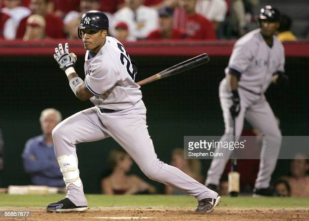 Robinson Cano of the New York Yankees drives in a run in the second inning against the Los Angeles Angels of Anaheim during Game Two of the American...
