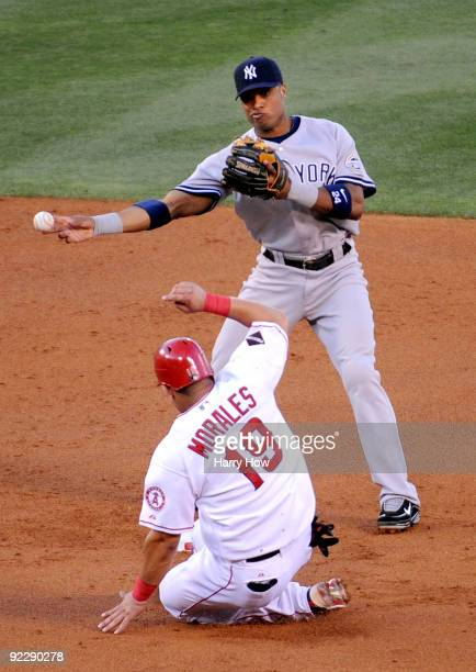 Robinson Cano of the New York Yankees forces Kendry Morales of the Los Angeles Angels of Anaheim out at second base during the first inning in Game...