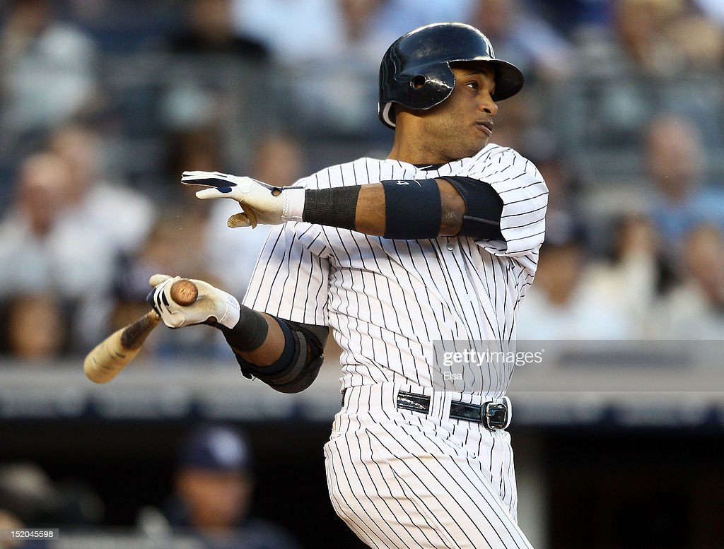 Robinson Cano #24 of the New York Yankees gets a hits against the Tampa Bay Rays on September 15, 2012 at Yankee Stadium in the Bronx borough of New York City.