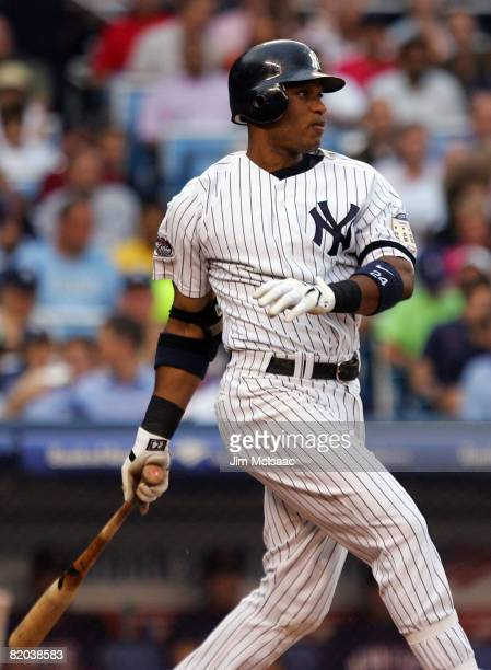 Robinson Cano of the New York Yankees hits an RBI single in the second inning against the Minnesota Twins at Yankee Stadium July 22, 2008 in the...