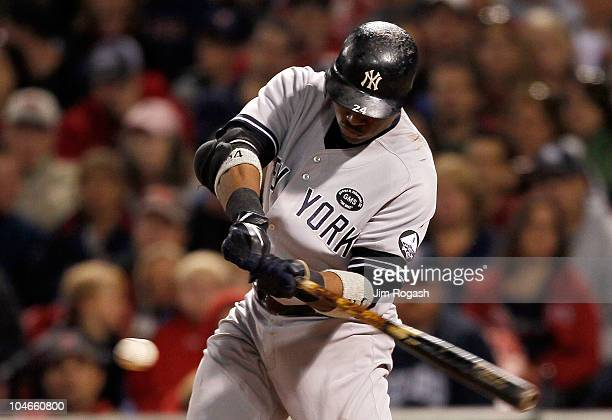 Robinson Cano of the New York Yankees keeps his eyes on the ball as he connects for a double during the first game of a doubleheader against the...