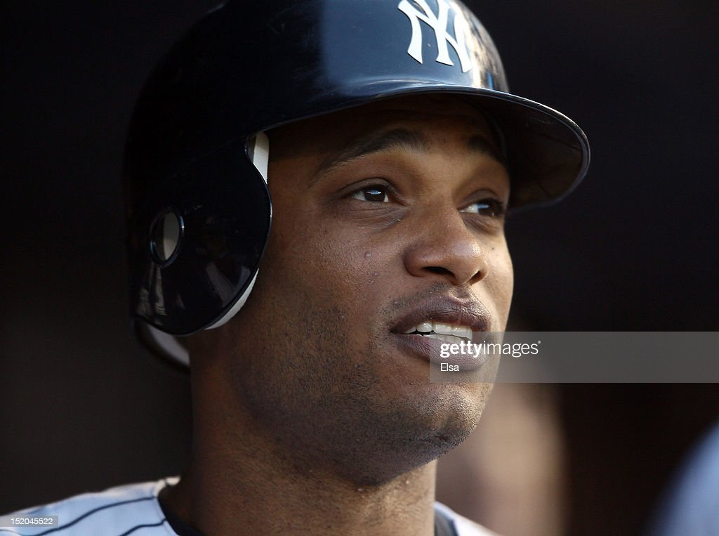 Robinson Cano #24 of the New York Yankees looks on from the dugout after he scored a run against the Tampa Bay Rays on September 15, 2012 at Yankee Stadium in the Bronx borough of New York City.