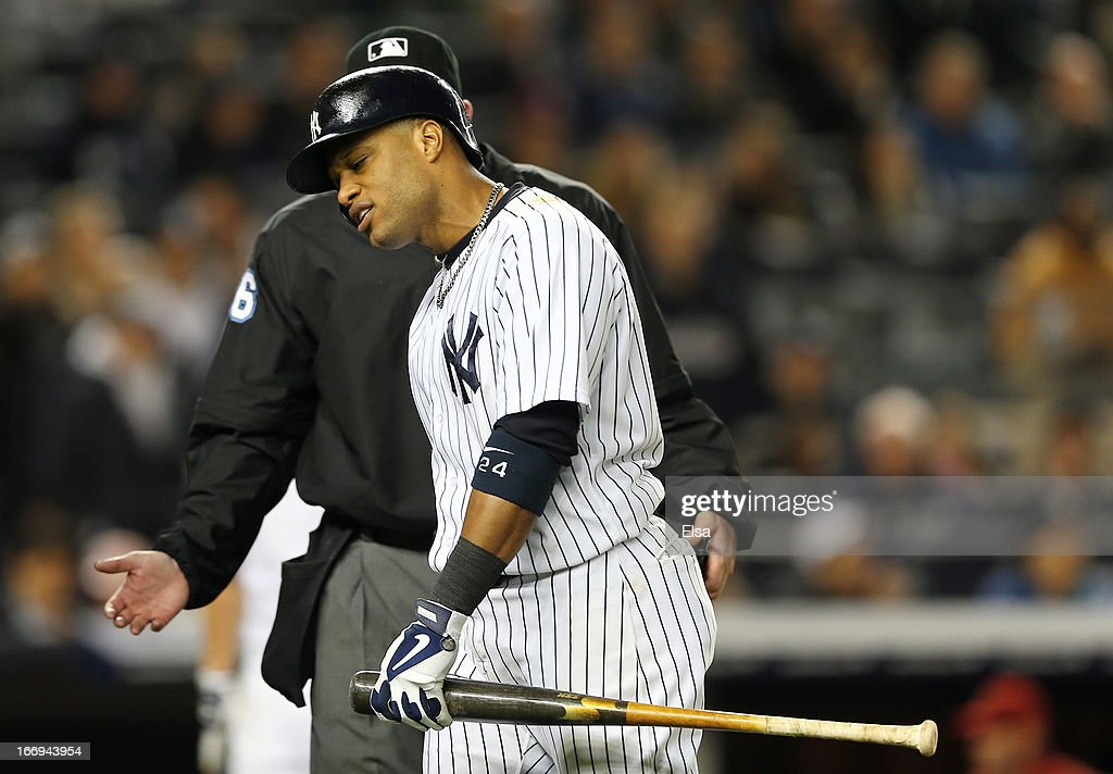Robinson Cano #24 of the New York Yankees reacts after he is called out with the bases loaded against the Arizona Diamondbacks on April 18, 2013 at Yankee Stadium in the Bronx borough of New York City.The Arizona Diamondbacks defeated the New York Yankees 6-2 in 12 innings.