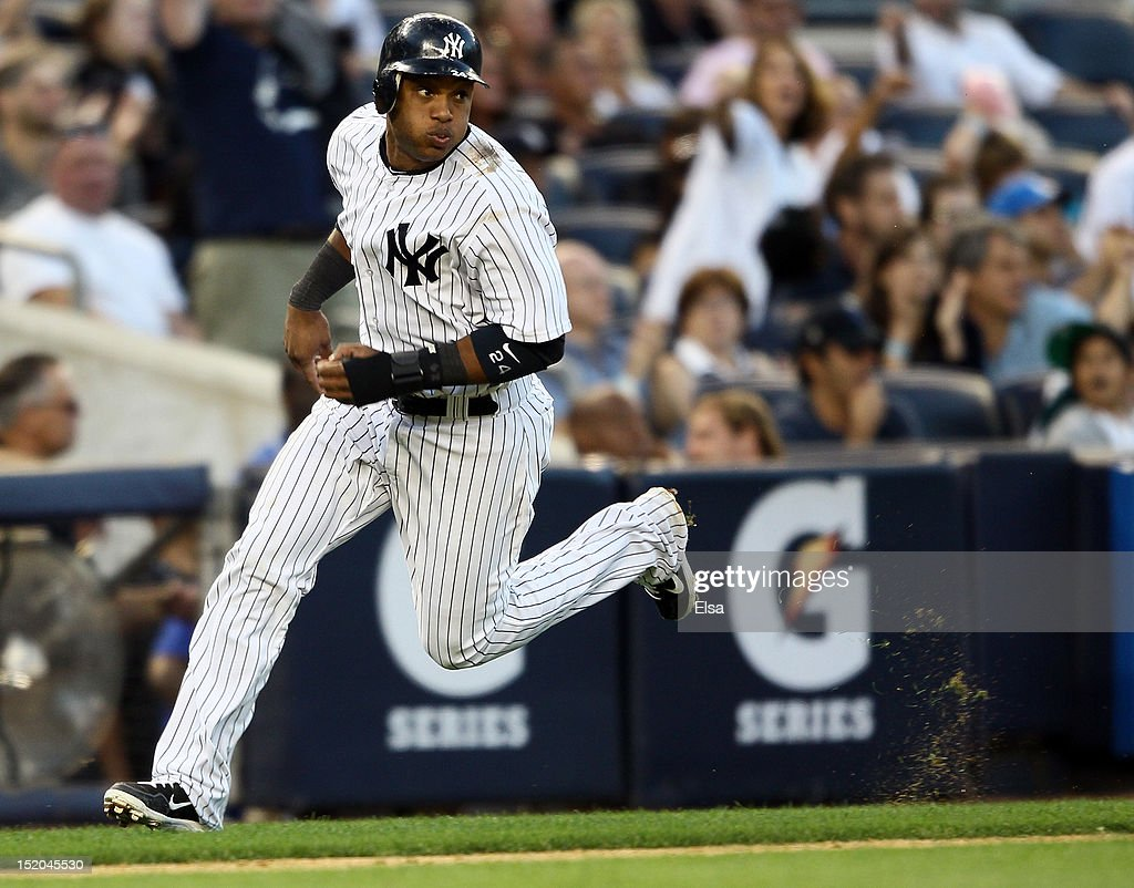 Robinson Cano #24 of the New York Yankees scores a run against the Tampa Bay Rays on September 15, 2012 at Yankee Stadium in the Bronx borough of New York City.
