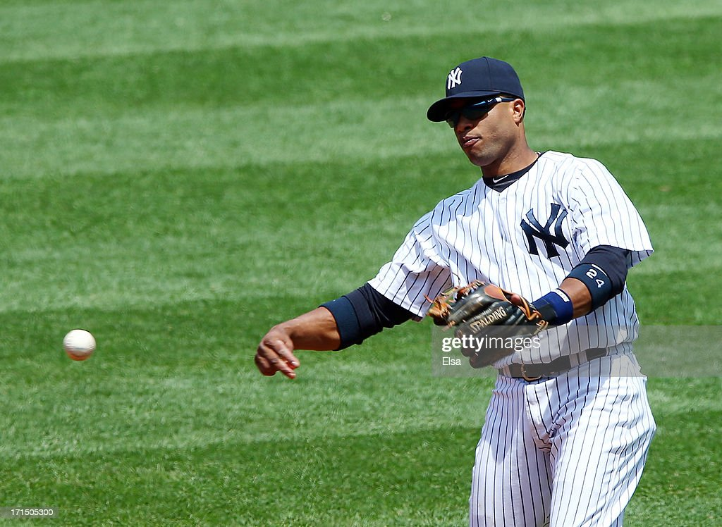 Robinson Cano #24 of the New York Yankees sends the ball to first base during the game against the Tampa Bay Rays on June 22,2013 at Yankee Stadium in the Bronx borough of New York City.