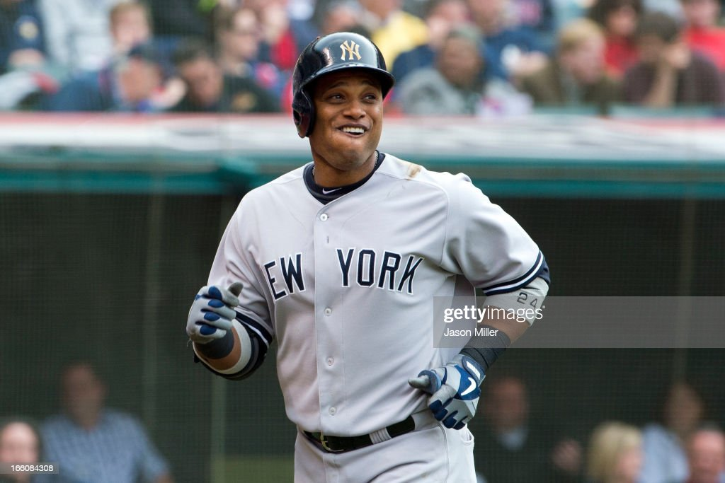 Robinson Cano #24 of the New York Yankees smiles after hitting a solo home run in the sixth inning against the Cleveland Indians on opening day at Progressive Field on April 8, 2013 in Cleveland, Ohio.