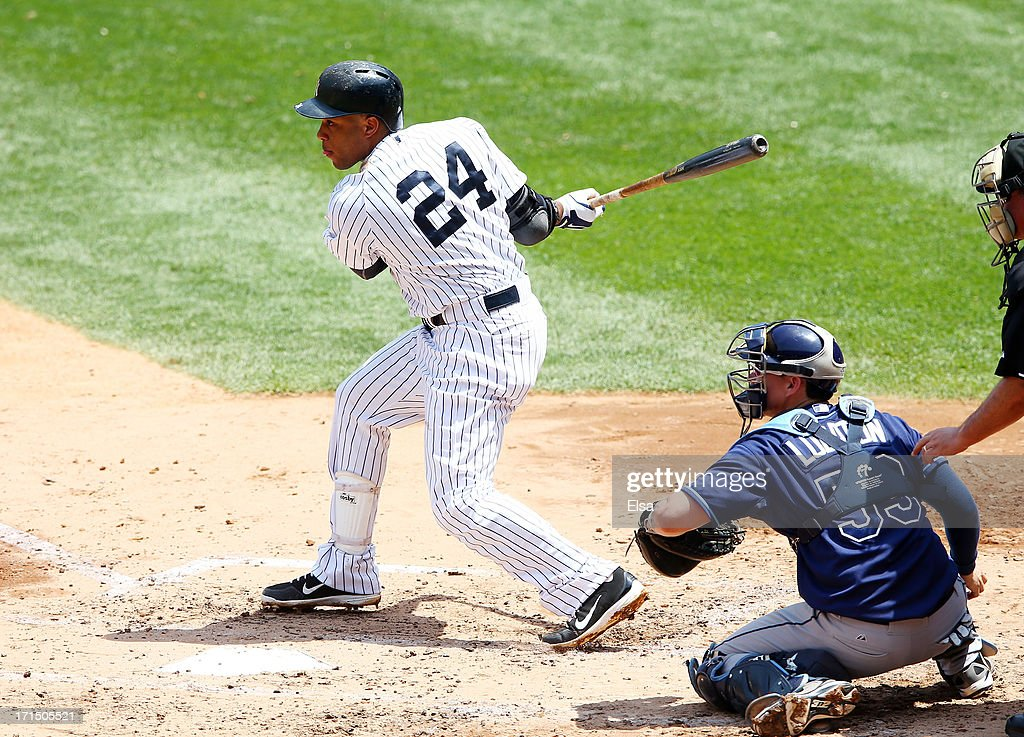 Robinson Cano #24 of the New York Yankees takes his turn at bat as Jose Lobaton #59 of the Tampa Bay Rays catches on June 22,2013 at Yankee Stadium in the Bronx borough of New York City.