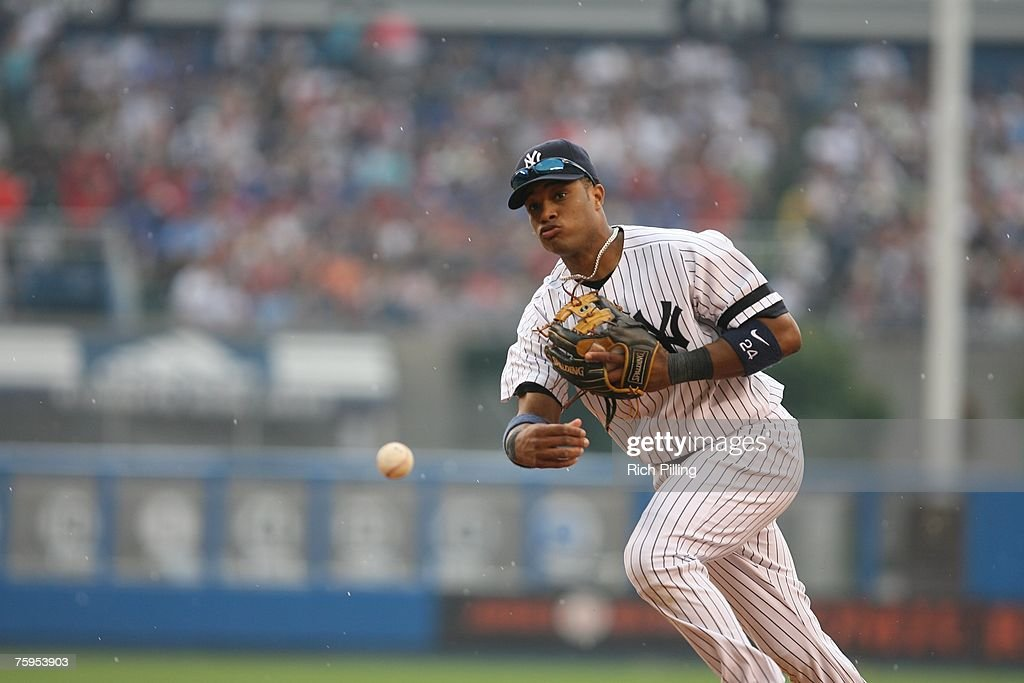 Robinson Cano of the New York Yankees throws during the game against the Toronto Blue Jays at the Yankee Stadium in the Bronx, New York on July 19, 2007. The Blue Jays defeated the Yankees 3-2.